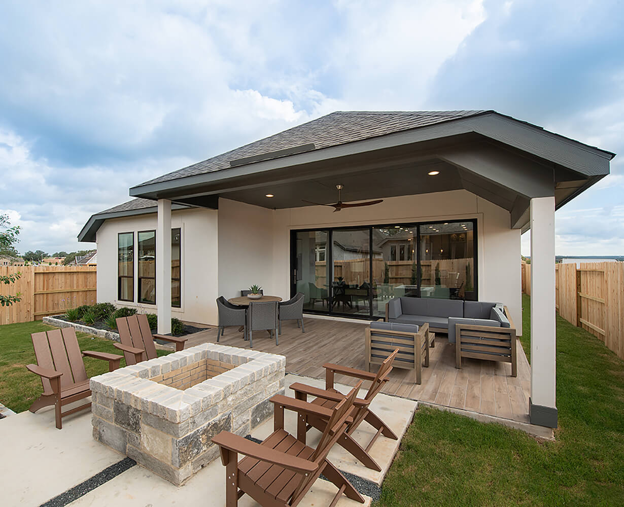 Perry Homes Backyard Outdoor Living Area with Firepit Photo